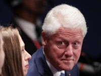 ST LOUIS, MO - OCTOBER 09:  (R-L) Former U.S. President Bill Clinton, daughter Chelsea Clinton and Marc Mezvinsky sit before the town hall debate at Washington University on October 9, 2016 in St Louis, Missouri. This is the second of three presidential debates scheduled prior to the November 8th election.  (Photo by Scott Olson/Getty Images)