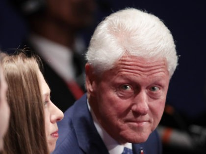 ST LOUIS, MO - OCTOBER 09: (R-L) Former U.S. President Bill Clinton, daughter Chelsea Clinton and Marc Mezvinsky sit before the town hall debate at Washington University on October 9, 2016 in St Louis, Missouri.