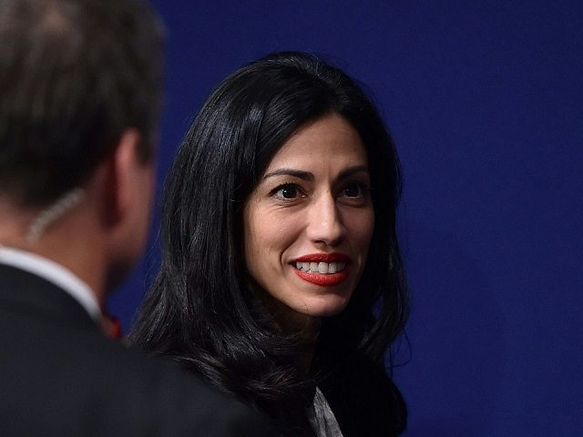 Huma Abedin, political staffer and aide to Democratic presidential candidate Hillary Clinton, is seen following the second presidential debate at Washington University in St. Louis, Missouri on October 9, 2016. / AFP / Paul J. Richards (Photo credit should read PAUL J. RICHARDS/AFP/Getty Images)