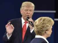 Republican presidential candidate Donald Trump speaks as Democratic presidential candidate Hillary Clinton walks past during the second presidential debate at Washington University in St. Louis, Missouri on October 9, 2016. / AFP / Paul J. Richards (Photo credit should read PAUL J. RICHARDS/AFP/Getty Images)