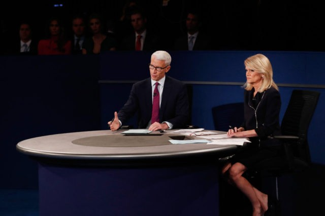 ST LOUIS, MO - OCTOBER 09: Moderator Anderson Cooper of CNN (L) speaks as moderator Martha Raddatz of ABC looks on during the town hall debate at Washington University on October 9, 2016 in St Louis, Missouri. This is the second of three presidential debates scheduled prior to the November …