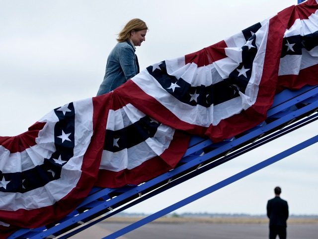 Jennifer Palmieri, Clinton campaign communications director, boards Democratic presidential nominee Hillary Clinton's campaign plane at Pueblo Memorial Airport October 12, 2016 in Pueblo, Colorado. / AFP / Brendan Smialowski (Photo credit should read