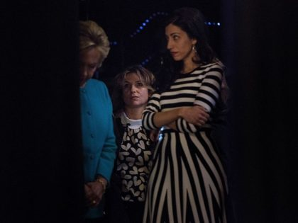 Democratic presidential nominee Hillary Clinton (L) waits back stage with hair stylist Isabelle Goetz (C) and close aid Huma Abedin before speaking during a fundraiser at the Paramount Theater October 14, 2016 in Seattle, Washington. / AFP / Brendan Smialowski (Photo credit should read BRENDAN SMIALOWSKI/AFP/Getty Images)
