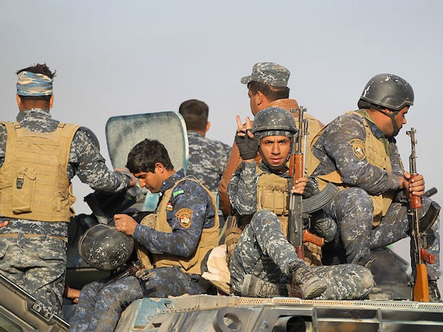 Iraqi forces deploy in the area of al-Shourah, some 45 kms south of Mosul, as they advance towards the city to retake it from the Islamic State (IS) group jihadists, on October 17, 2016. Iraqi Prime Minister Haider al-Abadi announced earlier in the day that the long-awaited operation to recapture …