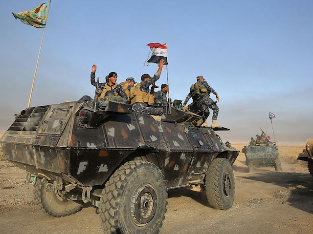 Iraqi forces deploy in the area of al-Shourah, some 45 kms south of Mosul, as they advance towards the city to retake it from the Islamic State (IS) group jihadists, on October 17, 2016. Iraqi Prime Minister Haider al-Abadi announced earlier in the day that the long-awaited operation to recapture Mosul was under way. / AFP / AHMAD AL-RUBAYE (Photo credit should read AHMAD AL-RUBAYE/AFP/Getty Images)