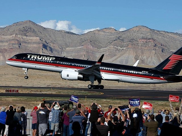 GRAND JUNCTION, CO - OCTOBER 18: Supporters cheer as the plane of Republican presidential candidate Donald Trump lands on October 18, 2016 in Grand Junction Colorado. Trump, who spoke at a rally after landing, is on his way to Las Vegas for the third and final presidential debate against Democratic …