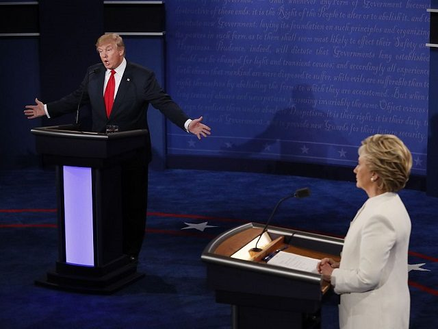 Republican presidential nominee Donald Trump speaks as Democratic presidential nominee Hillary Clinton (R) looks on during the final presidential debate at the Thomas & Mack Center on the campus of the University of Las Vegas in Las Vegas, Nevada on October 19, 2016. / AFP / Mark RALSTON (Photo credit …