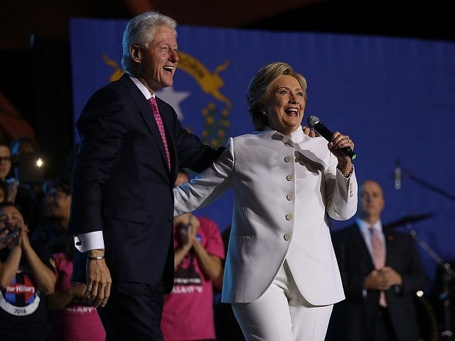 Hillary loses her cool when heckler yells 'Bill Clinton is a rapist'