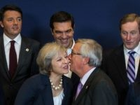 Theresa May kissing Jean-Claude Juncker