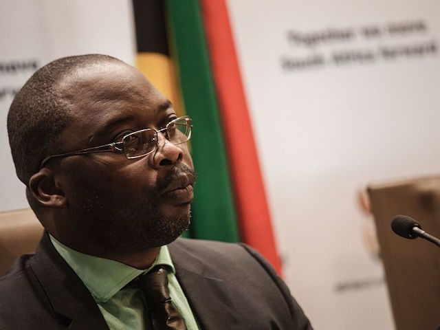 South African Justice Minister Michael Masutha gives a press briefing in Pretoria on October 21, 2016 regarding South Africa's decision to withdraw from the International Criminal Court (ICC). South Africa announced on October 21 that it is withdrawing from the ICC, dealing a major blow to a troubled institution set …