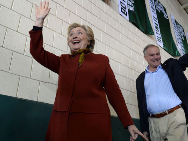 TOPSHOT - Democratic presidential nominee Hillary Clinton attends a campaign event with her running mate Tim Kaine, October 22, 2016 at Taylor Allderdice High School in Pittsburgh, Pennsylvania. / AFP / Robyn Beck (Photo credit should read ROBYN BECK/AFP/Getty Images)