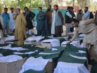 Pakistani mourners gather around the coffins of some of those killed in an attack on the Police Training College Balochistan in Quetta on October 25, 2016. Pakistan on October 25 mourned the killing of at least 61 people in a brutal gun and suicide bomb assault on a police academy, the deadliest attack on a security installation in the country's history. / AFP / BANARAS KHAN        (Photo credit should read BANARAS KHAN/AFP/Getty Images)