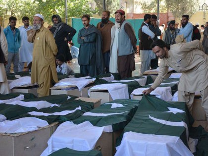 Pakistani mourners gather around the coffins of some of those killed in an attack on the Police Training College Balochistan in Quetta on October 25, 2016. Pakistan on October 25 mourned the killing of at least 61 people in a brutal gun and suicide bomb assault on a police academy, …