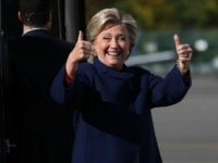 Democratic presidential nominee former Secretary of State Hillary Clinton give thumbs-up as she boards her campaign plane at Westchester County Airport on October 25, 2016 in White Plains, New York. With two weeks to go until election day, Hillary Clinton is traveling to Florida to campaign. (Photo by