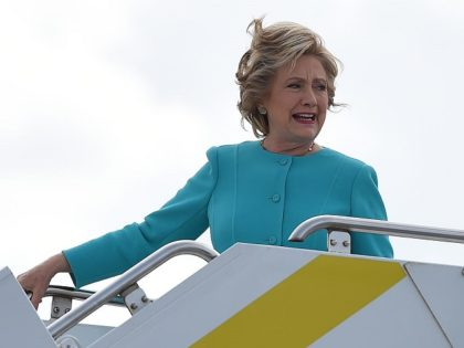 Democratic presidential nominee Hillary Clinton arrives at Palm Beach International Airport for a day of campaign in Palm Beach, Florida, October 26, 2016. / AFP / Robyn BECK (Photo credit should read ROBYN BECK/AFP/Getty Images)
