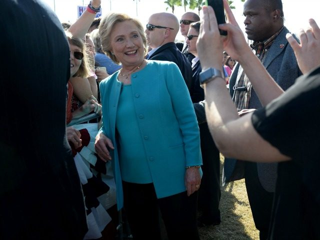 Democratic presidential nominee Hillary Clinton poses for photos with supporters at a rally in Curtis Hixon Waterfront Park in Tampa, Florida, October 26, 2016.