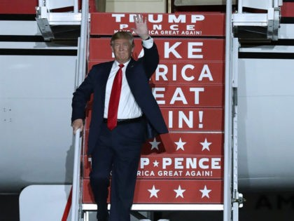 ALBUQUERQUE, NM - OCTOBER 30: Republican presidential nominee Donald Trump steps off of his private jet as he arrives for a campaign rally at Atlantic Aviation near Albuquerque International Airport October 30, 2016 in Albuquerque, New Mexico. With less than nine days until Americans go to the polls, Trump is …
