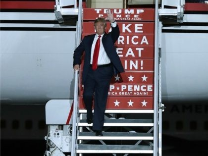 Republican presidential nominee Donald Trump steps off of his private jet as he arrives for a campaign rally at Atlantic Aviation near Albuquerque International Airport October 30, 2016 in Albuquerque, New Mexico. With less than nine days until Americans go to the polls, Trump is campaigning in Nevada, New Mexico …