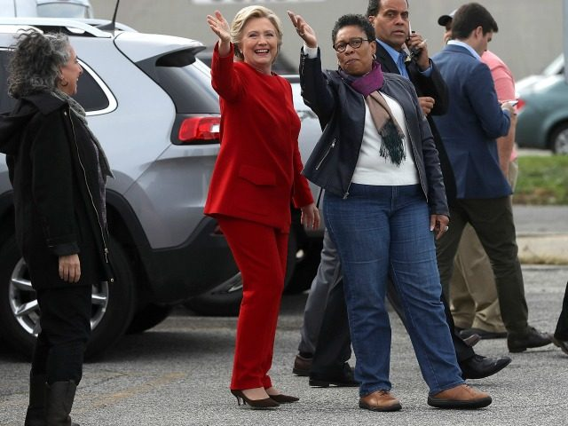 Hillary Clinton (C) jokes with U.S. Rep Marcia Fudge (D-OH) (R) on October 31, 2016 in Cleveland, Ohio.