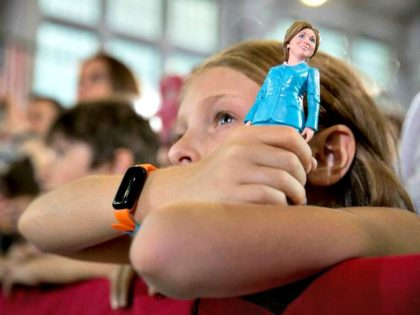 Girl and Hillary Doll AP