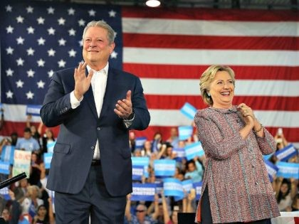 MIAMI, FL - OCTOBER 11: Democratic presidential nominee former Secretary of State Hillary Clinton and former Vice President Al Gore campaign together at the Miami Dade College - Kendall Campus, Theodore Gibson Center on October 11, 2016 in Miami, Florida.Clinton continues to campaign against her Republican opponent Donald Trump with …