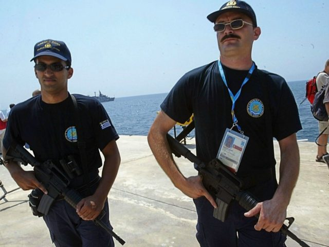 ATHENS, GREECE - AUGUST 9: Greek special police secure the 2004 Olympic Games zone in the port of Pireaus, on August 9, 2004 where luxury liners have been hired to serve as floating hotels for state leaders and VIPs during the Athens Olympics. The liners will be docked for the …