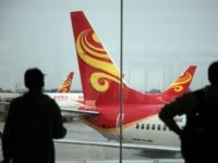 Passengers look on June 12, 2014 at planes belonging to China's Hainan Airlines at the gate at Haikou airport in south China's Hainan province. Hainan Airlines is finalizing a deal to buy 50 fuel-efficient 737 MAX passenger planes from US aircraft maker Boeing, the two companies announced on July 16. …