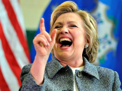 Hillary Laughing AP/Jessica Hill