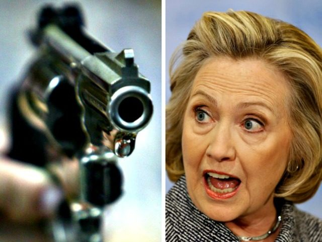 Hillary yells at a gun AP Photos