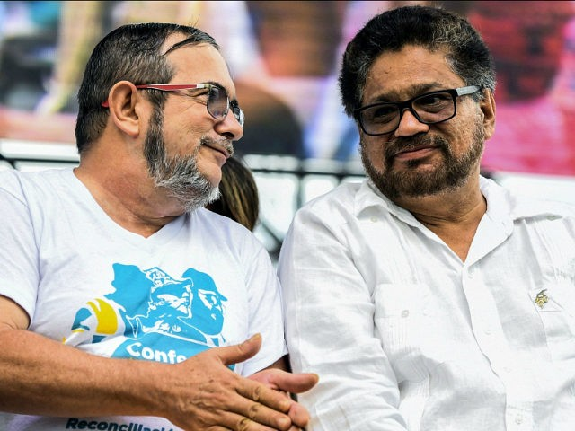 Revolutionary Armed Forces of Colombia (FARC) leaders Ivan Marquez (R) and Timoleon Jimenez aka 'Timochenko' talk during the announcement of the approval of the peace deal with the government during the closing ceremony of the 10th National Guerrilla Conference in Llanos del Yari, Caqueta department, Colombia, on September 23, 2016. Timoleon 'Timochenko' Jimenez will remain the leader of the FARC when they relaunch as a political party under a historic peace deal, commander Carlos Antonio Lozada told AFP Thursday. / AFP / LUIS ACOSTA (Photo credit should read LUIS ACOSTA/AFP/Getty Images)