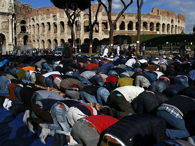 Muslim men attend the Friday prayers during a demonstration near Rome's ancient Colosseum on October 21, 2016. Members of the Muslim community of Rome gathered by the Colosseum to pray and demonstrate against the alleged shutting down of unofficial mosques by the police. / AFP / GABRIEL BOUYS (Photo credit …