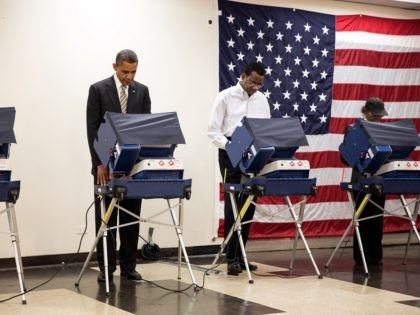 President Barack Obama casts his ballot during early voting at the Martin Luther King Jr. Community Center in Chicago, Ill., Oct. 25, 2012. (Official White House Photo by Pete Souza) This official White House photograph is being made available only for publication by news organizations and/or for personal use printing …