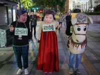 Protesters wear Park Geun Hye Mask with performance during an anti-President protest in Seoul, South Korea, on 27 October 2016. An influence-peddling scandal engulfing President Park Geun-hye has put the spotlight on the most powerful office in South Korea, rekindling interest in potential presidential candidates for next Decembers election. Park, …