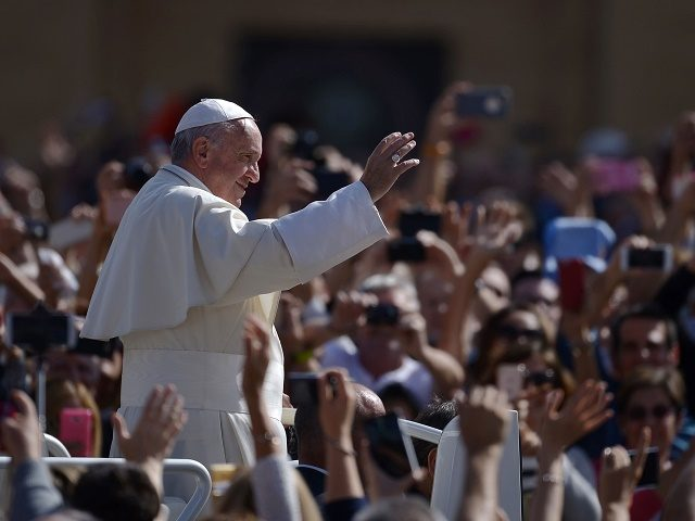 Pope Francis greets the crowd from the popemobil after a mass on October 9, 2016 at St Peter's square in Vatican. / AFP / FILIPPO MONTEFORTE (Photo credit should read FILIPPO MONTEFORTE/AFP/Getty Images)