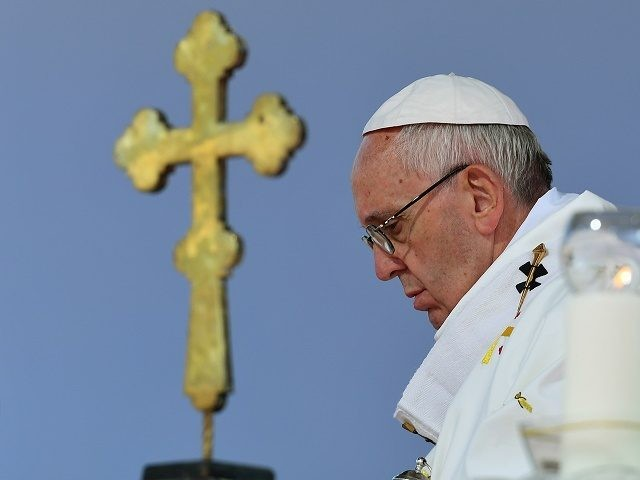 Pope Francis (R) celebrates a Holy Mass at the stadium in Tbilisi on October 1, 2016. Pope Francis landed in Georgia on September 30 for a visit billed as a mission of peace to the volatile Caucasus region that will also take him to Azerbaijan just months after he visited …
