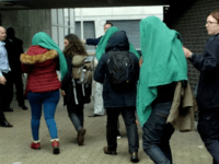 EXCLUSIVE PICS: 'Child' Migrants Arrive in UK Covered by Blankets