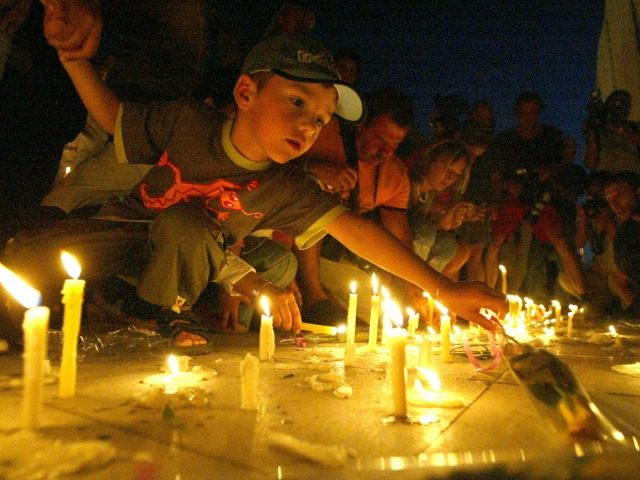 People light candles in front of Ghazala Gardens Hotel July 24, 2005 in the resort town of Sharm el-Sheik, Egypt. A rapid series of explosions killed over 80 people in the Egyptian Red Sea resort in the early morning hours of July 23 devastating a mall, a luxury hotel and …