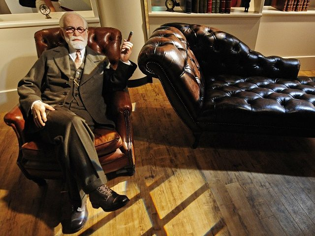 A wax likeness of Austrian founder of the psychoanalysis Sigmund Freud sits in Berlin's Madame Tussaud's wax museum, during a press preview of the museum on July 3, 2008. The museum opens to the public on July 5. AFP PHOTO DDP/ CLEMENS BILAN GERMANY OUT (Photo credit should read CLEMENS …