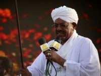 The incumbent president and candidate of the ruling National Congress Party (NCP) for Sudans presidency Omar al-Bashir gives a speech on March 31, 2015 in the capital Khartoum, during a campaign meeting ahead of the April 13 parliamentary and presidential elections. The National Electoral Commission has said some 14 candidates are competing with Bashir for the presidency but most are little-known and pose no real threat to his reelection bid. AFP PHOTO / ASHRAF SHAZLY (Photo credit should read ASHRAF SHAZLY/AFP/Getty Images)