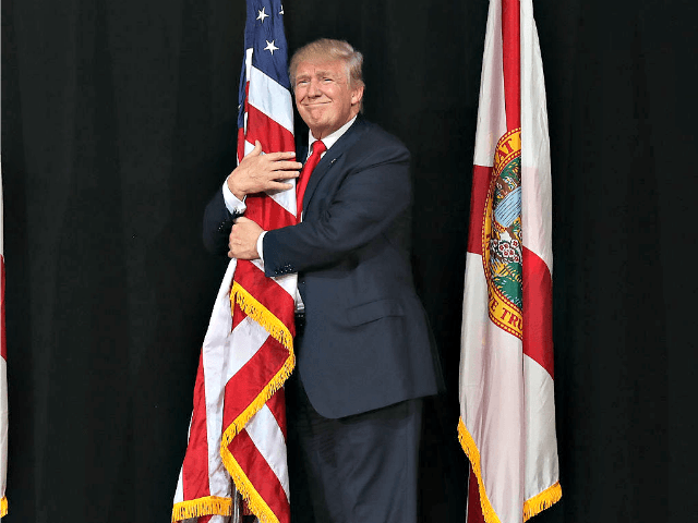 Trump Hugs Flag in Tampa Joe RaedleGetty