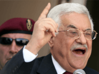 Palestinian President Mahmud Abbas gestures as he addresses a crowd of demonstrators at the Palestinian Authority headquarters in the West Bank city of Ramallah, 30 August 2006. Workers from a cross section of trade unions representing Palestinian Authority employees marched to the PA headquarters to demand their salaries. Unemployment levels …