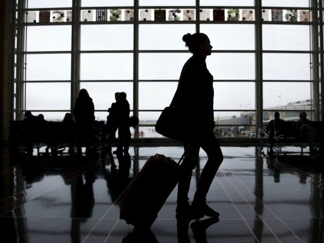 Passengers walk through the terminal as they head to their flights at Reagan National Airport in Arlington, Virginia, December 23, 2015. More than 100 million holiday travelers are expected to travel in the US during the last weeks of the year according to the American Automobile Association. AFP PHOTO / …