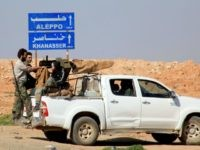 Syrian pro-government forces advance on a road through the town of Khanasser, which is the sole link between government-held areas in and around Aleppo and those in the rest of the country, after they reportedly recaptured it from Islamic State (IS) group fighters, on February 29, 2016. The Syrian army …