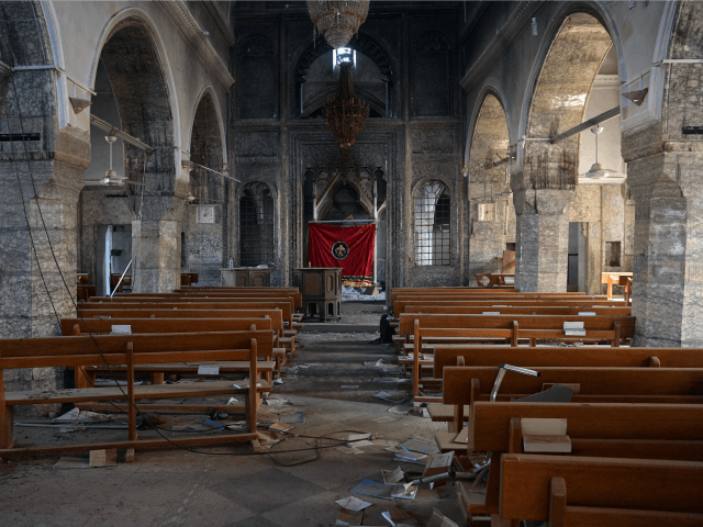 A church that was partially destoyed by Islamic State is pictured during the offensive to recapture the city of Mosul from Islamic State militants, on October 23, 2016 in Bartella, Iraq. Despite stiff opposition, Iraqi and Kurdish forces have continued advancing towards Iraq's second largest city of Mosul and are …