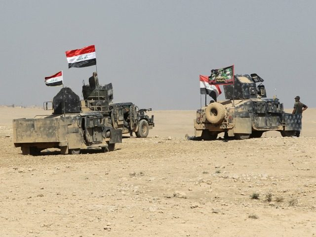 Iraqi forces deploy in the Bajwaniyah village, about 30 kms south of Mosul, on October 18, 2016 after they liberated the village from Islamic State (IS) group jihadists. Tens of thousands of Iraqi forces were making gains on the Islamic State group in Mosul in an offensive US President Barack …