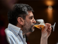 A sommelier tastes beers during the 2016 Cervezas de America Cup, in Santiago, on September 27, 2016. In the 2016 Cervezas de America Cup producers from 16 countries will compete presenting more than 1000 varieties of craft beers from 248 breweries, to become the largest event in Latin America and …