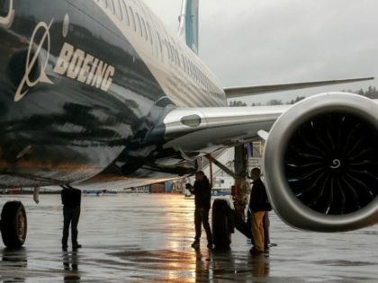 Boeing's first 737 MAX named the 'Spirit of Renton' is parked on the tarmac at the Boeing factory in Renton, Washington on December 8, 2015. The latest version of Boeing's best-selling 737, introduced in the mid-1960s, is due to make its first flight early next year and reach customers in …