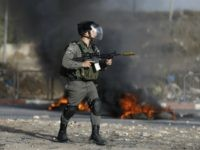 An Israeli border guard holds a rifle with a rubber bullet attachment during clashes with Palestinian youths in the West Bank town of al-Ram, north of Jerusalem, on October 9, 2016. A Palestinian opened fire from a car in Jerusalem and again as Israeli police chased him, killing an officer …