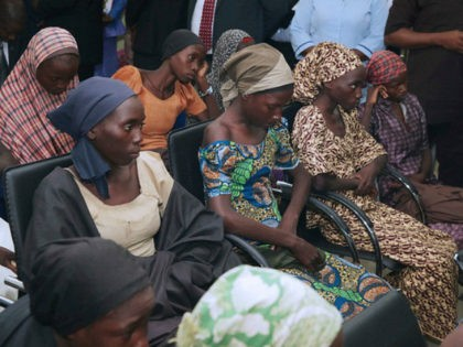 In this photo released by the Nigeria State House, freed Chibok school girls sit during a meeting with Nigeria Vice President ,Yemi Osinbajo, in Abuja,, Nigeria, Thursday, Oct. 13, 2016. Twenty-one of the Chibok schoolgirls kidnapped by Boko Haram more than two years ago were freed Thursday in a swap …