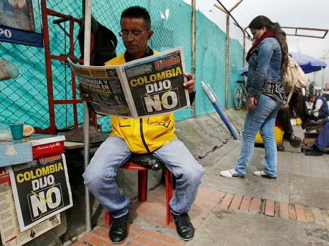 "A man reads a newspaper with the headline that reads in Spanish: ""Colombia said No"" in Bogota, Colombia, Monday, Oct. 3, 2016. Voters rejected a peace deal with leftist rebels of the Revolutionary Armed Forces of Colombia, FARC, by a razor-thin margin in a national referendum Sunday, dismissing years of …"